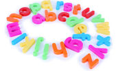 Colorful magnetic letters isolated on white — Stock Photo