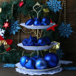 Stock Photo: Christmas decorations on dessert stand, on color wooden background
