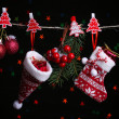 Santa sock, hat and Christmas accessories on black background with lights — Stock Photo #38029577