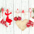 Christmas accessories hanging on white wooden wall — Stock Photo #38029593