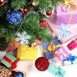 Stock Photo: Decorated Christmas tree with gifts, close up, isolated on white