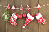 Christmas accessories hanging on grey wooden wall — Stock Photo