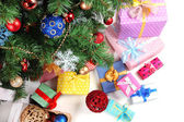 Decorated Christmas tree with gifts, close up, isolated on white — Stock Photo