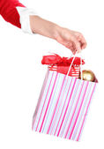 Hand holds package with New Year gift isolated on white — Stock Photo