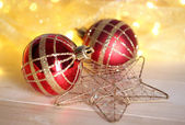 Christmas ornaments and garland on wooden table close-up — Stok fotoğraf