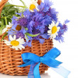 Beautiful bouquet of cornflowers and chamomiles in basket, isolated on white — Stock Photo #38100891