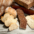 Much bread on wooden board — Stock Photo #38101059