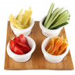 Bright fresh vegetables cut up slices in bowls isolated on white — Stock Photo #38101303
