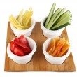 Bright fresh vegetables cut up slices in bowls isolated on white — Stock Photo