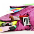 Purple backpack with school supplies isolated on white — Stock Photo #38102187