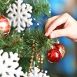Decorating Christmas tree on bright background — Stok fotoğraf #38102519