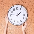 Clock on wall background — Stock Photo #38102655