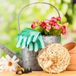 Gardening tools and flowers on wooden table, outdoors — Stock Photo