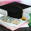 Stock Photo: Money for graduation or training on wooden table close-up
