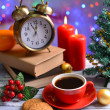 Stock Photo: Composition of book with cup of coffee and Christmas decorations on table on bright background