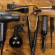 Hairdressing tools on wooden table close-up — Stock Photo #38104787