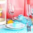 Table serving with colorful tableware on room background — Stock Photo #38105201