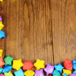 Stock Photo: Paper stars with dreams on wooden background
