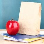 School breakfast on desk on board background — Stock Photo