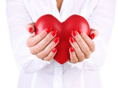 Red heart in woman's hands isolated on white — Stock Photo