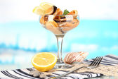 Cocktail of mussels in vase on blue natural background — Stock Photo