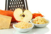 Metal grater and apple, cheese, carrot, isolated on white — Stock Photo