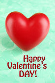Decorative red heart on color background — Stock Photo