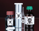Deadly poison in bottles on black background — Stock Photo