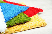 Many carpets of different colors close-up — Stock Photo