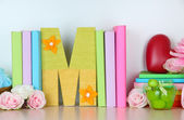 Shelf decorated with handmade knit letter — Stock Photo