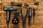 Hairdressing tools on wooden table close-up — Stock Photo