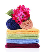 Colorful towels and flowers, isolated on white — Stock Photo
