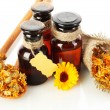 Medicine bottles and calendula, isolated on white — Stock Photo #38183869