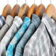 Stock Photo: Shirts with ties on wooden hangers isolated on white