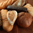 Much bread on wooden board — Stock Photo #38184931