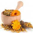 Fresh and dried calendula flowers in wooden mortar isolated on white — Stock Photo #38185045
