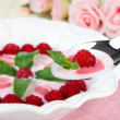 Stock Photo: Sweet cream soup with fresh raspberry and sour cheese, on light background