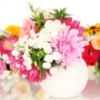 Beautiful bouquet of bright flowers in glass vase, isolated on white — Stock Photo #38185351