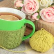 Stock Photo: Cup of tewith knitted thing on it close up