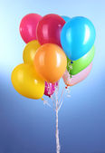 Colorful balloons on blue background — Stock Photo