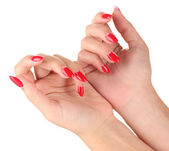 Beautiful female hands with red nails isolated on white — Stock Photo