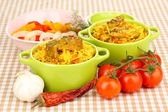 Delicious pilaf with vegetables on tablecloth background — Stock Photo