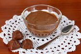 Bowl of chocolate and sweets on wooden background — Stock Photo