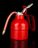 Red oil can, isolated on black — Stock Photo