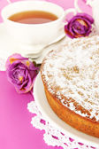 Delicious poppy seed cake with cup of tea on table close-up — Stock Photo
