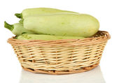 Fresh marrows in wicker basket, isolated on white — Stock Photo