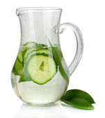 Cold water with cucumber and ice in pitchers isolated on white — Stock Photo