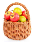 Small apples in wicker basket, isolated on white — Stock Photo
