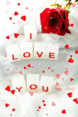 Candles with printed sign I LOVE YOU,on white fabric background — Stockfoto