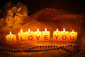 Candles with printed sign I LOVE YOU,on dark background — Stock fotografie